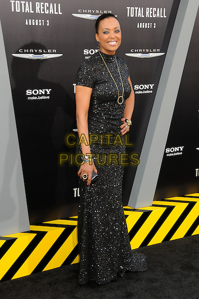 "Aisha Tyler.""Total Recall"" Los Angeles Premiere held at Grauman's Chinese Theatre, Hollywood, California, USA..August 1st, 2012.full length black sparkly dress hand on hip necklace gold clutch bag.CAP/ADM/BP.©Byron Purvis/AdMedia/Capital Pictures."