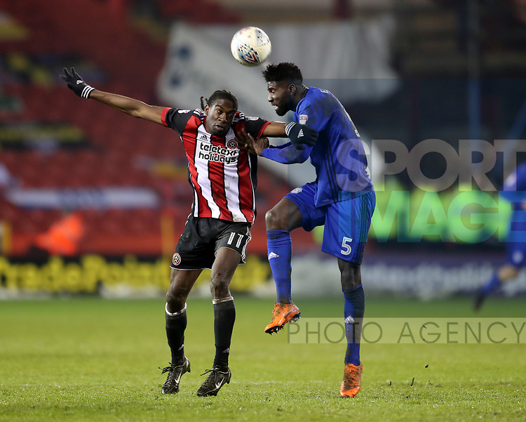 Clayton Donaldson of Sheffield Utd challenges Bruno Manga of Cardiff City during the Championship match at Bramall Lane Stadium, Sheffield. Picture date 02nd April, 2018. Picture credit should read: Simon Bellis/Sportimage