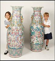 BNPS.co.uk (01202 558833)<br /> Pic: Dukes/BNPS<br /> <br /> ***Please use full byline***<br /> <br /> Isabella (8) and Oliver (6) Schwinge are dwarfed by the vases.<br /> <br /> A pair of enormous 200-year-old Chinese vases that were given to a<br /> church minister as thanks for saving a boy's life have come to light.<br /> <br /> They had been a gift to The Reverend Samuel Edward Valpy Filleul by a<br /> rich trader who he had rescued from drowing years before.<br /> <br /> The rare 5ft porcelain antiques were recently stumbled on in the<br /> hallway of a house - and are now tipped to fetch upwards of &pound;100,000.<br /> <br /> The Reverend Filleul had been fishing by a river in the late 1800s<br /> when he heard cries for help and rushed to the rescue of the boy.<br /> <br /> The pair became friends and the Reverend paid for the boy to go to school.<br /> <br /> Thanks to his education the boy grew up to become a successful trader,<br /> making his fortune in China.<br /> <br /> As thanks for saving his life, he shipped two giant vases to his mentor.<br /> <br /> The vases, intricately decorated with Chinese myths, are thought to<br /> come from the reign of Daoguang, the Qing Dynasty Emperor, who ruled<br /> over China from 1820 to 1850.