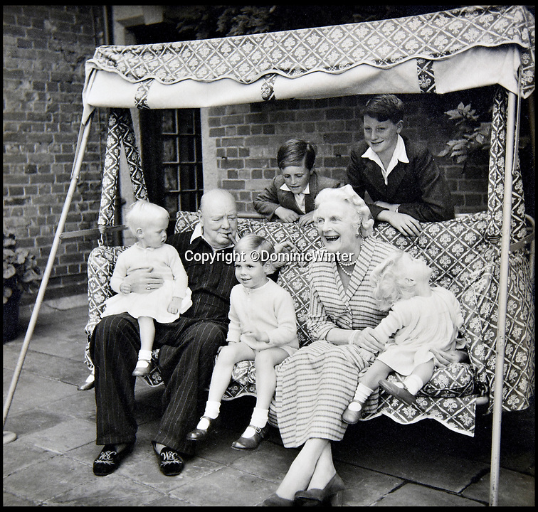 BNPS.co.uk (01202 558833)<br /> Pic:  DominicWinter/BNPS<br /> <br /> Winston Churchill with his wife Clementine and five of his grandchildren.<br /> <br /> Charming photos of Winston Churchill with his grandchildren have emerged for sale - alongside one of his trademark cigars.<br /> <br /> The candid snaps reveal Churchill enjoying the company of his wife Clementine and their grandchildren at Chartwell, their family home.<br /> <br /> They were taken in 1951, at which point he had just been re-installed as Prime Minister after a six year absence.<br /> <br /> The partly-smoked cigar was taken by a naval officer as a memento of the British wartime leader's stay on board HMS Pembroke in 1943.