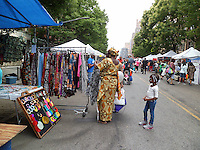 Harlem Week street fair is celebrated on West 135th Street in Harlem in New York on Sunday, August 18, 2013. (© Frances M. Roberts)