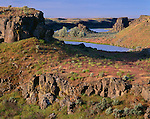 Columbia National Wildlife Refuge, WA<br /> Morning light on basalt cliffs and grasslands at Katy Lake, Drumheller Channels National Natural Landmark