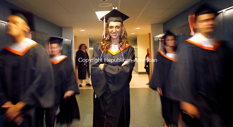 Watertown, CT- 17, April 2011-061711CM07 FOR COOPERS STORY: Joanna Shields poses for a photo with fellow classmates before the start of Watertown High School's commencement exercises Friday night.   Christopher Massa Republican-American