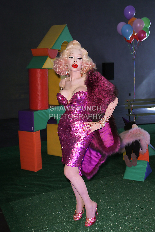 """Amanda Lepore poses in an outfit from the Adrienne Landau Fall Winter """"Landauland"""" collection fashion presentation co-produced by Susanne Bartsch and Saula Villela, at 111 West 19th Street, on February 14, 2017; during New York Fashion Week: Women's Fall Winter 2017."""