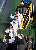 Expedition 54 flight engineer Scott Tingle of NASA, top, flight engineer Norishige Kanai of Japan Aerospace Exploration Agency (JAXA), middle, and Soyuz Commander Anton Shkaplerov of Roscosmos, bottom, wave farewell prior to boarding the Soyuz MS-07 rocket for launch, Sunday, December 17, 2017 at the Baikonur Cosmodrome in Kazakhstan. Tingle, Norishige Kanai, and Shkaplerov will spend the next five months living and working aboard the International Space Station. <br /> Mandatory Credit: Joel Kowsky / NASA via CNP