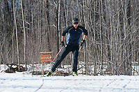 A nordic skier skate skiing on the Noquemanon Trails near Marquette Michigan.