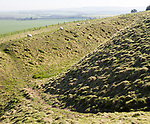 Defensive ditch and rampart at Barbury Castle Country Park, Iron Age hill fort, Wiltshire, England, UK