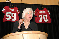 14 January 2007: Mary Gundelach presents an award at the annual football banquet at McCaw Hall in Stanford, CA.
