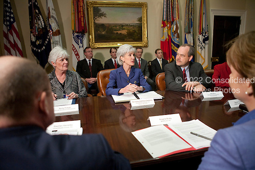 United States Secretary of Health and Human Services (HHS) Kathleen Sebelius, center, meets with insurance company executives and officials including Sandy Praeger, Kansas Insurance Department commissioner, left, and Joel Ario, Pennsylvania insurance commissioner, right, at the White House in Washington, D.C., U.S., on Thursday, March 4, 2010. .Credit: Brendan Hoffman / Pool via CNP