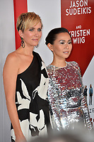 Kristen Wiig &amp; Hong Chau at the special screening of &quot;Downsizing&quot; at the Regency Village Theatre, Westwood, USA 18 Dec. 2017<br /> Picture: Paul Smith/Featureflash/SilverHub 0208 004 5359 sales@silverhubmedia.com