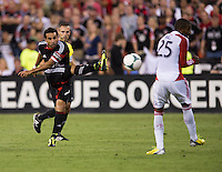 Dwayne De Rosario (7) of D.C. United takes a shot as Jeremy Hall (25) of Toronto blocks it during a game at RFK Stadium in Washington, DC.  D.C. United tied Toronto FC, 1-1.