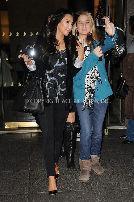 WWW.ACEPIXS.COM . . . . . ....December 8 2009, New York City....TV personality Kim Kardashian leaving a Radio Studio in Manhattan on December 8 2009 in New York City....Please byline: KRISTIN CALLAHAN - ACEPIXS.COM.. . . . . . ..Ace Pictures, Inc:  ..tel: (212) 243 8787 or (646) 769 0430..e-mail: info@acepixs.com..web: http://www.acepixs.com