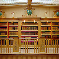 Detail of the book shelves built into the oak panelling of the gallery library