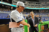 """7 March 2012:  FIU Head Coach Henry """"Turtle"""" Thomas shakes hands with Miami Marlins President David Samson prior to the start of the exhibition game as the Miami Marlins defeated the FIU Golden Panthers, 5-1, at Marlins Park in Miami, Florida."""
