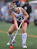 Annie Crowley #21 of Garden City moves the ball downfield during a Nassau County Conference I varsity field hockey match against Baldwin at Garden City High School on Friday, Sept. 30, 2016. Garden City won by a score of 7-0.
