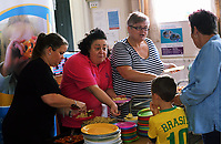 Pictured: Carolyn Harris MP (3rd L) with other volunteers hand out hot food to families at St Teilo Church in Clase, Swansea, UK. Friday 25 August 2017<br /> Re: Free food for children story, Swansea, Wales, UK.