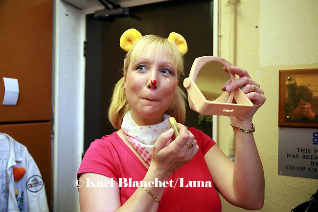 Sally Rigley, alias Dr Hunny, preparing her make up in a small room next to the reception of the Royal Manchester Children hospital. The make up is very minimalist to make sure children are not scared.