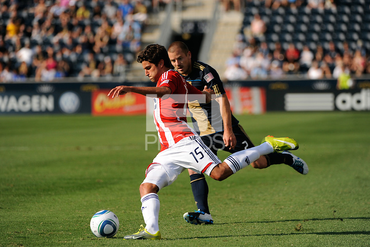 Sal Zizzo (15) of CD Chivas USA plays the ball in front of Jordan Harvey (2) of the Philadelphia Union. The Philadelphia Union defeated CD Chivas USA 3-0 during a Major League Soccer (MLS) match at PPL Park in Chester, PA, on September 25, 2010.