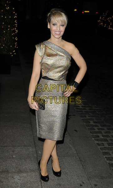 KATIE PIPER .At the Inspirational Women Of The Year Awards, Marriott Hotel, Grosvenor Square, London, England, UK, November 23rd 2010..full length gold silver one shoulder metallic dress hand on hip shoes clutch bag black bracelet cuff .CAP/CAN.©Can Nguyen/Capital Pictures.