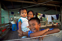 Sandakan, Sabah, Borneo, Malaysia, March 2006. children in on of Sandakans stilted houses. Photo by Frits Meyst/Adventure4ever.com