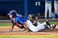May 31, 2009:  NCAA Division 1 Gainesville Regional:    Miami Catcher Teddy Foster is safe at home after Miami Catcher Yasmani Grandal missed the tag during regional action at Alfred A. McKethan Stadium on the campus of University of Florida in Gainesville.  The Florida Gators defeated the Miami Hurricanes 16-5 and will advance to the Super Regionals in Gainesville............