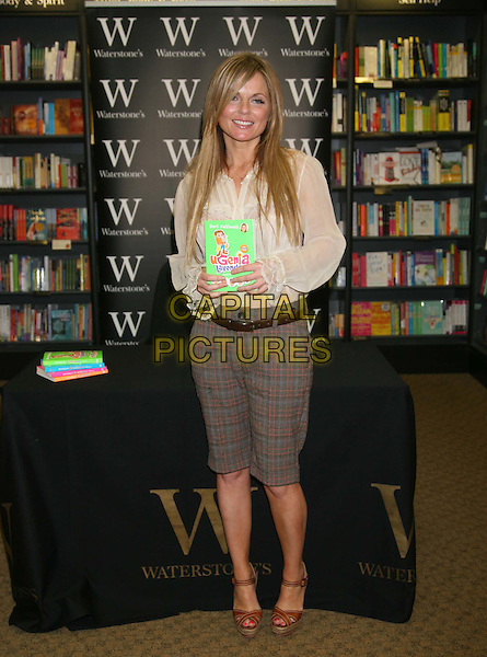 GERI HALLIWELL.At a book signing for children's Ugenia Lavender books at Bentall Centre, Kingston upon Thames, England..April 18th, 2009.booksigning full length white cream sheer blouse top  lace brown wedges shoes cropped shorts plaid tartan grey gray.CAP/DS.©Dudley Smith/Capital Pictures