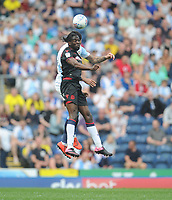Bolton Wanderers' Clayton Donaldson under pressure from Blackburn Rovers' Derrick Williams<br /> <br /> Photographer Kevin Barnes/CameraSport<br /> <br /> The EFL Sky Bet Championship - Blackburn Rovers v Bolton Wanderers - Monday 22nd April 2019 - Ewood Park - Blackburn<br /> <br /> World Copyright © 2019 CameraSport. All rights reserved. 43 Linden Ave. Countesthorpe. Leicester. England. LE8 5PG - Tel: +44 (0) 116 277 4147 - admin@camerasport.com - www.camerasport.com