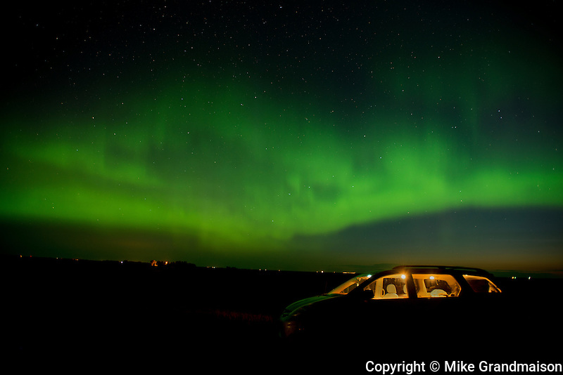 Northern lights (Aurora borealis) and automobile<br /> Indian Head<br /> Saskatchewan<br /> Canada