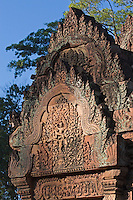 Bas relief in red sandstone of the West Gopura in the inner enclosure of Banteay Srei, 10th century Khmer architecture at Angkor Wat -  Siem Reap, Cambodia....