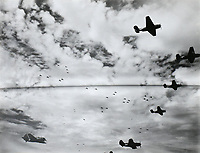 """""""Operation Tin Type"""" - TBF Avengers and SB2C Helldivers from the Shangri-La and Task Force 38 fly (near Tokyo?). 981 or 1000 planes from the 3rd Fleet buzzed the third fleet in parade formation. -  Aug. 22, 1945<br /> <br /> Photo by R.J. Guttosch"""