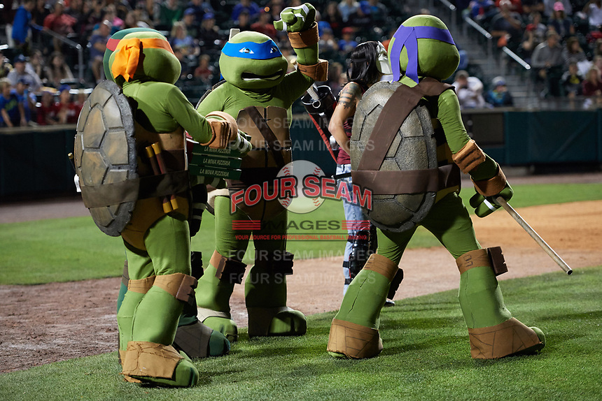 The Teenage Mutant Ninja Turtles during an on field performance after a Buffalo Bisons game against the Gwinnett Braves on August 19, 2017 at Coca-Cola Field in Buffalo, New York.  The Bisons wore special Superhero jerseys for Superhero Night.  Gwinnett defeated Buffalo 1-0.  (Mike Janes/Four Seam Images)