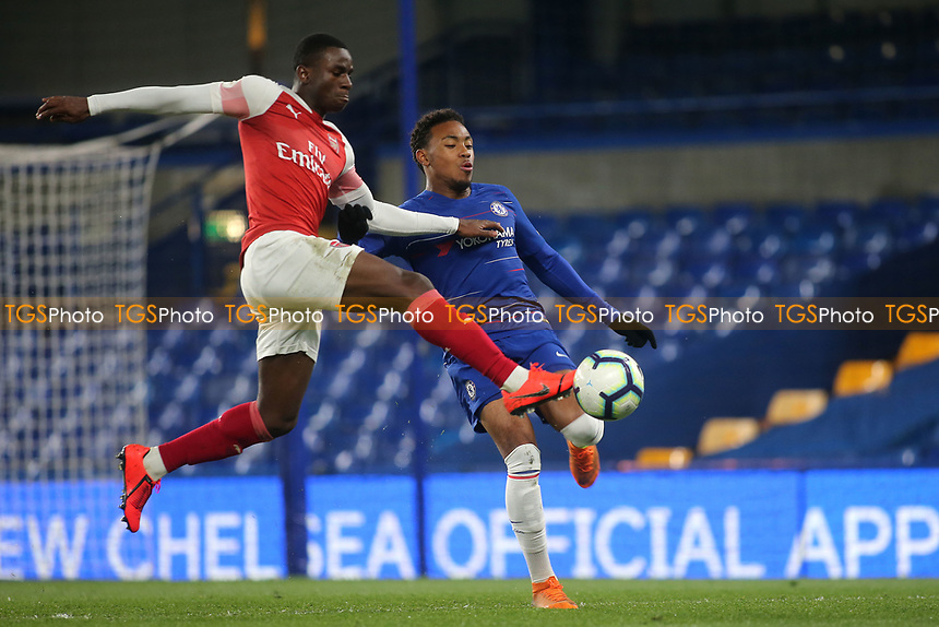 Jordi Osei-Tutu of Arsenal and Chelsea's Juan Castillo challenge for the ball during Chelsea Under-23 vs Arsenal Under-23, Premier League 2 Football at Stamford Bridge on 15th April 2019