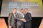 Wales Sport Awards 2013<br /> Paul Scarfi receiving his award from Justin Edinburgh<br /> 09.11.13<br /> ©Steve Pope-SPORTINGWALES