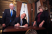 Retired United States Marine Corps General John Kelly signs his confirmation paperwork after being sworn-in as Secretary of Homeland Security by Vice President Mike Pence (L), in the Vice Presidential ceremonial office in the Executive Office Building in Washington, D.C. on January 20, 2017.     <br /> Credit: Kevin Dietsch / Pool via CNP