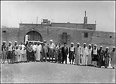 To commemorate the event, foremen and Egyptologists gathered before the inspector's office in Saqqara, around Frenchman Pierre Lacau, President of the Antiquities Department of Egypt (white beard), Englishman Walter Emery (wearing jodhpurs) and Egyptian Selim Hassan (tarboosh headgear) all posed for Chadouf.....CHADOUF MOHAMMED/COLLECTION PATRICK CHAPUIS-PHILIPPE FLANDRIN