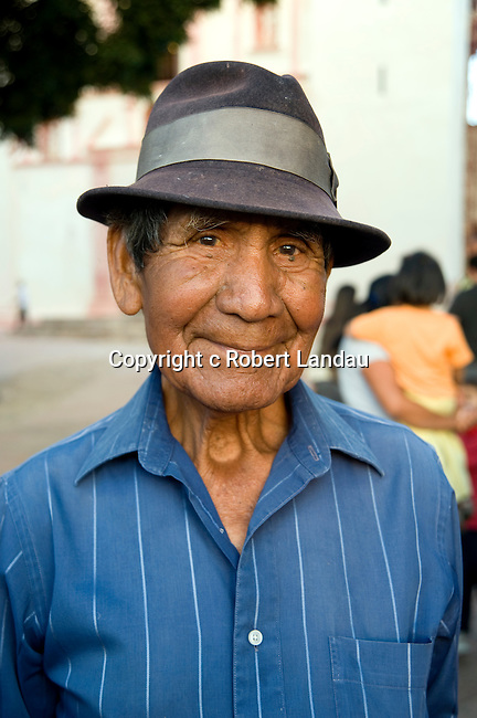 Portriat of local man at square near church in Oaxaca, Mexico