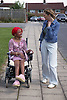 Young woman with disability out with a friend,