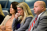 TALLAHASSEE, FLA. 3/4/14- Diena Thompson, center, mother of 7-year-old Somer Thompson who was abducted and killed in 2009 in Orange Park, becomes emotional during the Senate's discussion on a package of bills to strengthen laws against sex offenders during opening day of the legislative session, March 4, 2014 at the Capitol in Tallahassee. Joining Thompson is Jennifer Bradley of Fleming Island, left, and Thompson's fianc&eacute; Dennis Sullivan, right. <br /> <br /> COLIN HACKLEY PHOTO