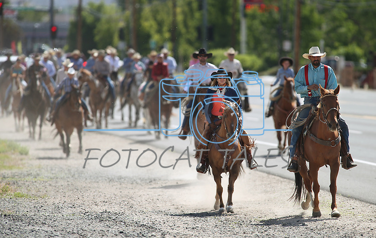 About 40 riders came down Highway 50 into Carson City, Nev., on Friday, May 30, 2014, to deliver a petition to the governor calling attention to the ongoing battle between ranchers and the BLM over grazing rights. <br /> Photo by Cathleen Allison