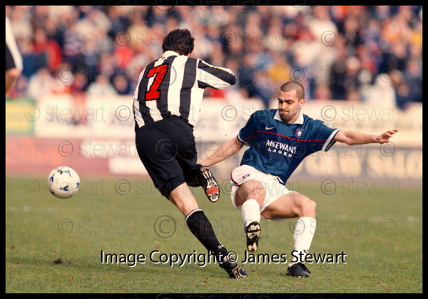 28th March 98      Copyright Pic : James Stewart   .Dunfermline v Rangers.GERRY BRITTON WRONG FOOTS SERGIO PORRINI.......Payments to :-.James Stewart Photo Agency, Stewart House, Stewart Road, Falkirk. FK2 7AS      Vat Reg No. 607 6932 25.Office : 01324 630007        Mobile : 0421 416997.If you require further information then contact Jim Stewart on any of the numbers above.........