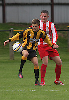 Ross Coyle being closed down by Scott Forrester in the Huntly v Wigtown & Bladnoch William Hill Scottish Cup 1st Round match, at Christie Park, Huntly on 25.8.12.