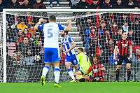 Will Grigg of Wigan Athletic (9) scores the first goal and celebrates as Nathan Ake of AFC Bournemouth on ground looks at his defenceduring AFC Bournemouth vs Wigan Athletic, Emirates FA Cup Football at the Vitality Stadium on 6th January 2018
