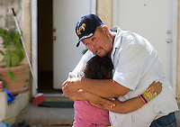 leaving0627 Vanessa Sanchez, 10, (CQ) hugs her godfather Salvador while saying gooby before move to Pennsylvania.  (Pat Shannahan/ The Arizona Republic)