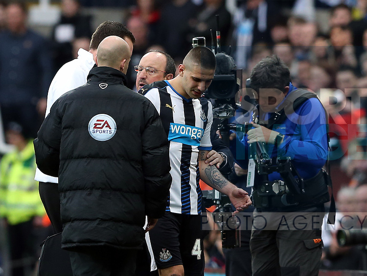 Newcastle United's Aleksandar Mitrovic, right, is told hes not allowed back on the pitch during the Barclays Premier League match at St James' Park Stadium. Photo credit should read: Scott Heppell/Sportimage