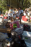 Students and their families unload their belongings for the start of the fall semester at Fashion Institute of Technology in New York on Saturday, August 16, 2008.  FIT is a unit of the State University of New York specializing in garment industry related education. (© Frances M. Roberts)