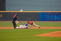 20 August 2007: Second Base #18 Ondrej Petrik tags out #16 Florian Peyrichou during the Czech Republic 6-1 victory over France in the Good Luck Beijing International baseball tournament (olympic test event) at the Wukesong Baseball Field in Beijing, China.
