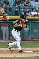 Tim Arakawa (4) of the Salt Lake Bees follows through on his swing against the Albuquerque Isotopes during the Pacific Coast League game at Smith's Ballpark on August 30, 2016 in Salt Lake City, Utah. The Bees defeated the Isotopes 3-2. (Stephen Smith/Four Seam Images)
