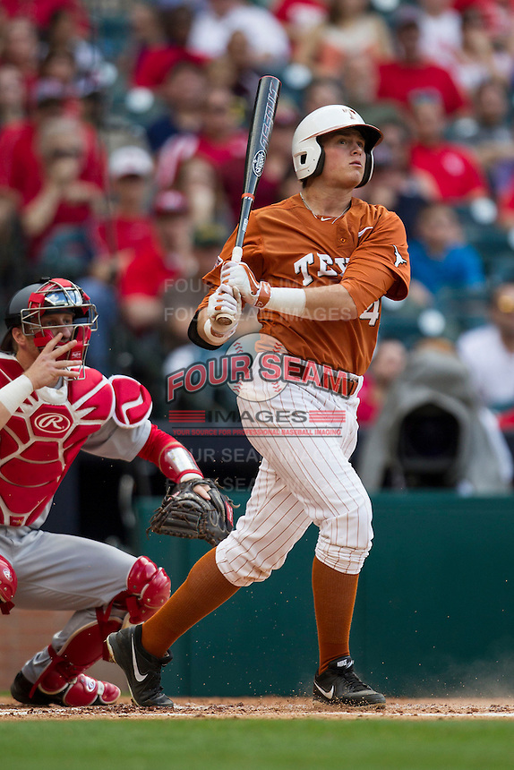 Texas Longhorns first baseman Kacy Clemens #42 follows through on his swing during the NCAA baseball game against the Houston Cougars on March 1, 2014 during the Houston College Classic at Minute Maid Park in Houston, Texas. The Longhorns defeated the Cougars 3-2. (Andrew Woolley/Four Seam Images)