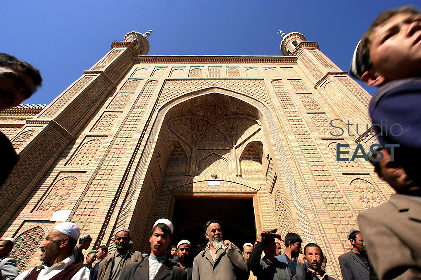 Muslims exit Hetian mosque after the Friday prayer, in Hetian, Xinjiang province, China, on October 13, 2006. The Uyghur people are a Turkic ethnic group living mainly in the Xinjiang Uyghur Autonomous Region of China. Photo by Lucas Schifres/Pictobank