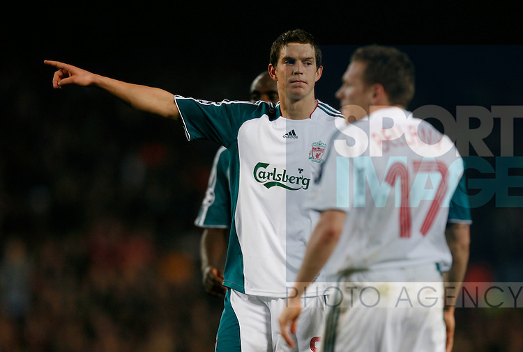 Liverpool's Daniel Agger points the way